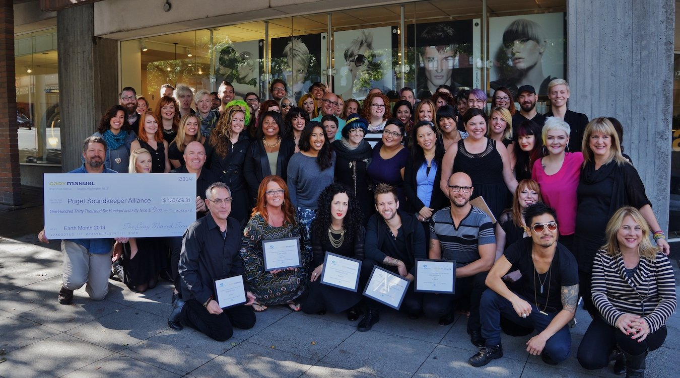 Gary Manuel Salon, the top fundraiser for Aveda Earth Month, presents their check to Soundkeeper staff.